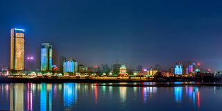 Nanchang River on both sides of the light show. Neon River and tall buildings compete for the moon. The 293 buildings are also `staged` lighting shows. They stock photos