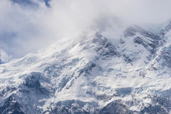 Nanga Parbat mountain peak in cloudy day, Fairy Meadow, Pakistan Royalty Free Stock Photography