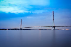 Nanjing cable stayed bridge in evening. The 3rd nanjing yangtze river bridge in evening,is the first arc shaped steel tower cable-stayed bridge in the world Stock Photography