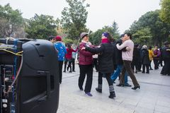 The nanjing crowd square dance. Many elderly people in nanjing, jiangsu province, in parks, citizens and other vacant lots for square dancing. Enrich old age Stock Photo