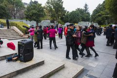 The nanjing crowd square dance. Many elderly people in nanjing, jiangsu province, in parks, citizens and other vacant lots for square dancing. Enrich old age Stock Photography