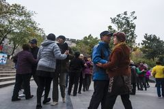 The nanjing crowd square dance. Many elderly people in nanjing, jiangsu province, in parks, citizens and other vacant lots for square dancing. Enrich old age Stock Image