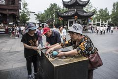 Tourists with direct drinking water in scenic spots. Nanjing Qinhuai District, Jiangsu Province, Confucius Temple Attractions, Three Older Tourists Directly stock photo