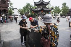 Tourists with direct drinking water in scenic spots. Nanjing Qinhuai District, Jiangsu Province, Confucius Temple Attractions, Three Older Tourists Directly royalty free stock photography