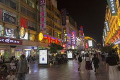 Nanjing road in Shanghai, China by night. Nanjing road is the biggest shopping street in Shanghai and one of the world`s busiest shopping streets. There are Royalty Free Stock Photography