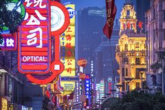 Nanjing Road Shanghai. SHANGHAI, CHINA - JUNE 16, 2014: Neon signs lit on Nanjing Road. The street is the main shopping road of the city Stock Images