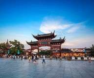 Nanjing scenery at dusk. Nanjing confucius temple and memorial arch with visitors motion blur at dusk,China Stock Image