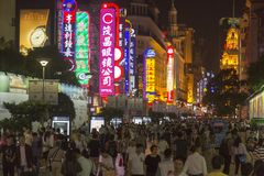 Nanjing road in Shanghai, China by night. Nanjing road is the biggest shopping street in Shanghai and one of the world`s busiest shopping streets. There are Royalty Free Stock Photo