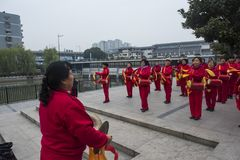 Nanjing wuding gate qinhuai river waist drum team. Jiangsu nanjing wuding gate park square, there is a group of enthusiasts, often carry on the waist inspiring Stock Photos