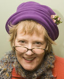 Nanny. Beauitful older woman with purple hat and red sweater Royalty Free Stock Photography