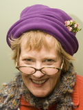 Nanny. Beauitful older woman wearing a purple hat and red sweater Royalty Free Stock Photos