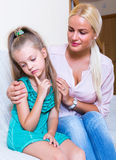 Nanny calming a fretful child Stock Images