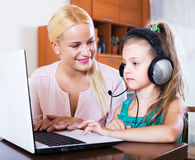 Nanny and girl playing computer game Royalty Free Stock Photos