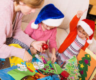 Nanny helping little daughters  to make decoration Stock Photography