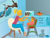 Nanny in the kitchen is feeding the child Royalty Free Stock Photo