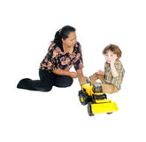 Nanny plays with little boy. A Filipino nanny sitting on the floor playing with a little three year old Royalty Free Stock Image