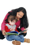 Nanny read book to little boy. Stock Photo
