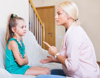 Nanny scolding at little girl Royalty Free Stock Images