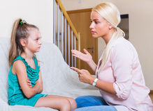 Nanny scolding at little girl Royalty Free Stock Image
