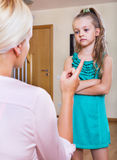 Nanny scolding at little girl Stock Photography