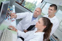 Nanotechnology interns in laboratory. Nanotechnology interns in the laboratory Royalty Free Stock Images