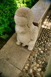 Stone sculpture of a little monkey on the stairs in Nanshan Park. Sanya, Hainan. stock photo