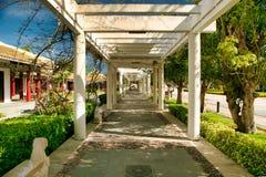 A long corridor next to the temple in Nanshan Park. Sanya, Hainan. stock photo