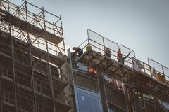 Workers who are working on the construction of new buildings in Royalty Free Stock Photography