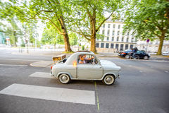 Nantes city in France. NANTES, FRANCE - May 27, 2017: Couple travel by retro car driving on the street in Nantes city in France Royalty Free Stock Image