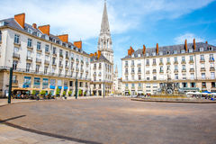 Nantes city in France. View on the Royal square with fountain and church tower in Nantes city in France Royalty Free Stock Image