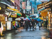 A group of tourist walking at a local market in Ita Thao village, Sun Moon Lake, Taiwan. royalty free stock photo