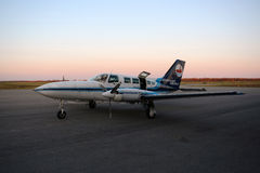 Nantucket Airlines Cessna 402 at sunset Royalty Free Stock Photo
