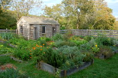 Nantucket, MA: Coffin House Colonial Garden. Colonial garden with flowers, herbs, and vegetables planted in raised boxes at the historic 1686 Jethro Coffin House Stock Photo