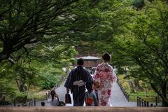 Nanzen-ji temple, couple enjoying a stroll in traditional clothing, kyoto, kansai, Japan royalty free stock photo
