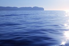 Nao Cape far view blue reflection water. Alicante province Spain Royalty Free Stock Photos