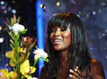 Naomi with flowers. American model Naomi Campbell with flowers Royalty Free Stock Image