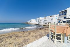 Naoussa village and beach - Aegean Sea - Paros Cyclades island - Greece. View of Naoussa village and beach - Aegean Sea - Paros Cyclades island - Greece royalty free stock photos