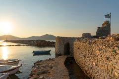 Naoussa village and harbor at sunset - Aegean Sea - Paros Cyclades island - Greece. View of Naoussa village and harbor at sunset - Aegean Sea - Paros Cyclades stock images