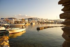 Naoussa village and harbor at sunset - Aegean Sea - Paros Cyclades island - Greece. View of Naoussa village and harbor at sunset - Aegean Sea - Paros Cyclades royalty free stock photos