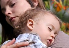 Nap. Baby sleeping on her mother outdoor Royalty Free Stock Photo