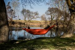 Nap in a hammock at the water`s edge stock photo