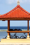 Nap Time. Two people napping under a gazebo at the water's edge, Bali royalty free stock images