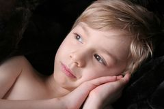Nap Time. A little boy is taking a rest royalty free stock photo