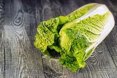 Napa or Chinese cabbage on wooden background royalty free stock photography