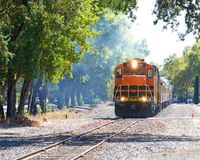 Wine train in Napa Valley on tracks with hazy background. Napa Valley, CA - October 22, 2017: The Napa Valley Wine Train takes passengers on a 36 mile round trip stock image