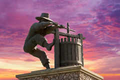 Napa Valley California Wine Crusher Monument to Entrance to Famous Wine Country. Wine colored sky behind the Napa Valley California wine crusher monument in a Royalty Free Stock Photos