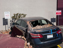 Napa Valley Earthquake, bad car day. Parked beneath an old brick building in Napa this car suffered major damage when parts of the 3 story building collapsed Royalty Free Stock Photo