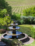 Napa Valley Idyll. Beautiful landscape with water fountain and vineyards in Napa Valley, California Royalty Free Stock Photo