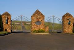 Napa Valley vineyard and mansion behind the gates. At sunset Royalty Free Stock Photos