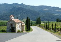 Napa Valley Vineyards. View of Napa Valley Vineyards and hills with a church-like structure in the foreground royalty free stock image